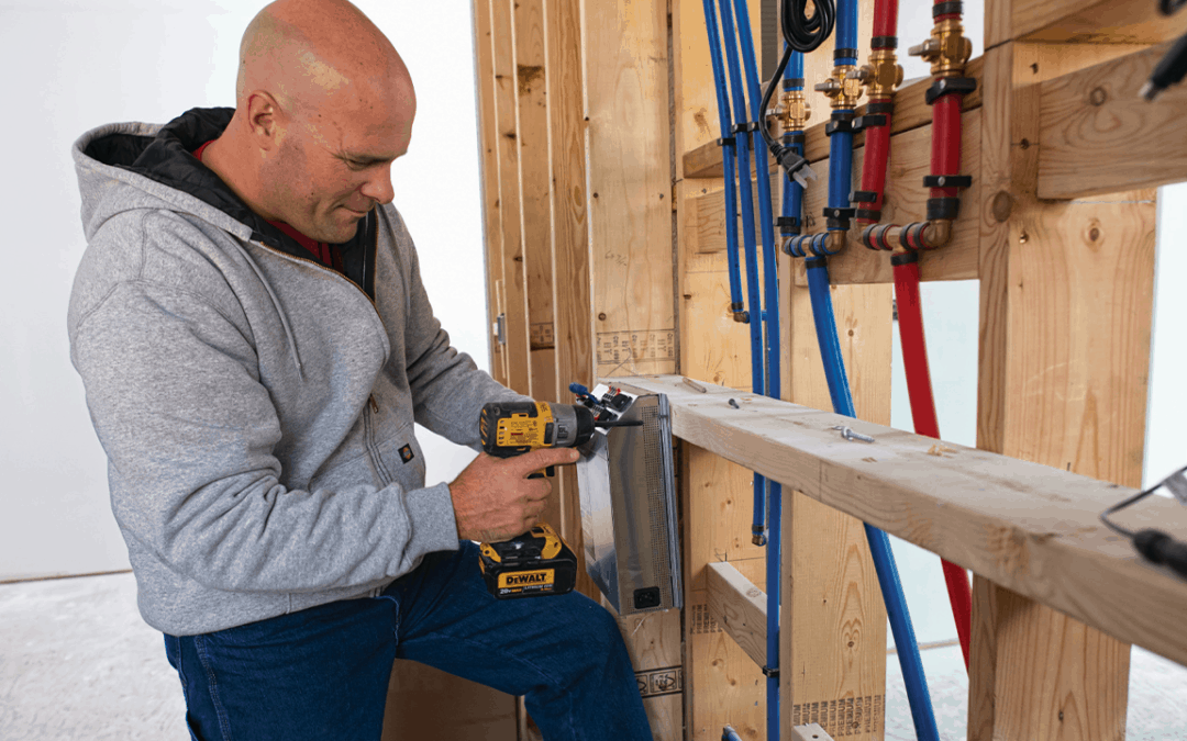 Bryan Baeumler iSolar Partnership - Bryan Baeumler in house framing with sander